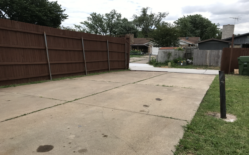 before drive way and fence home renovation